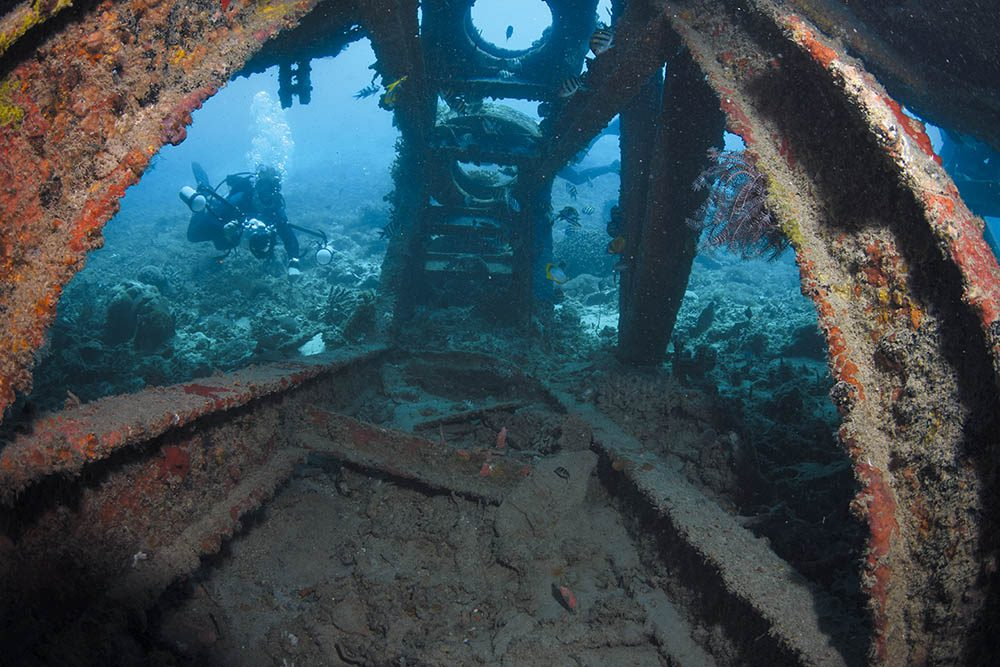 A diver explores the underside of the Bounty Wreck.