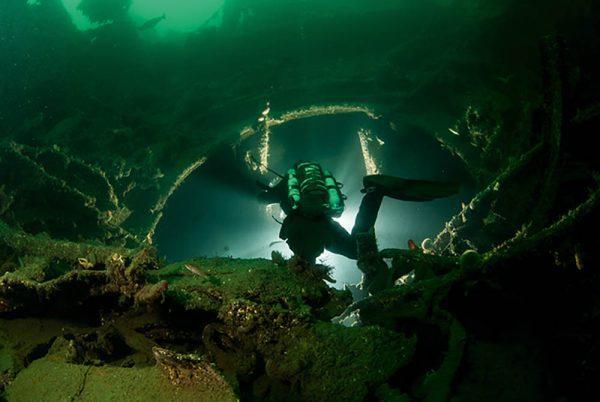 A diver descends into the base of the Caesar turret barbette.