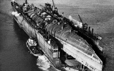 The battlecruiser Derfflinger on floating dry dock en route for breaking.