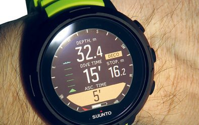 Suunto D5 deco read-out showing ascent time, and deep-stop level, with compass rose navigation displayed.