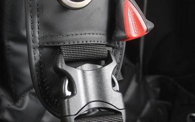 Right side shoulder-strap, D-ring, designer dump toggle and pinch clip-strap adjuster.