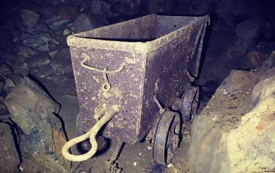 An old mine-cart, still on the rails as it was left.