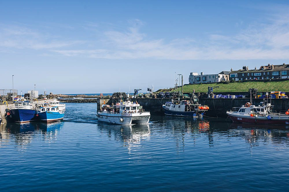 Boat entering Seahouses harbour.