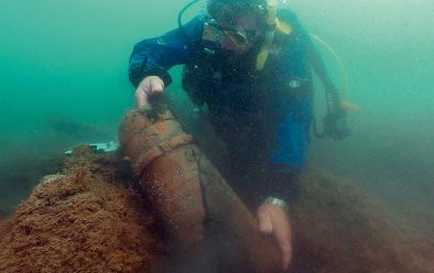 Finds are photographed under water, like this powder case…