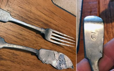 The silver fish knife and fork found on the wreck, with the letter T for Tindell on the handles.